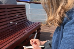 Taking notes on the ferry on the Mersey River.